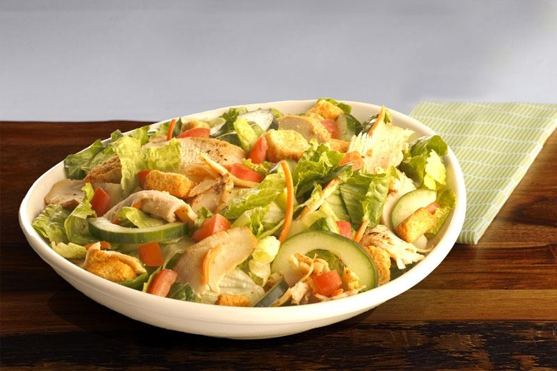 WOW Covington salad shown in white plate on wood table