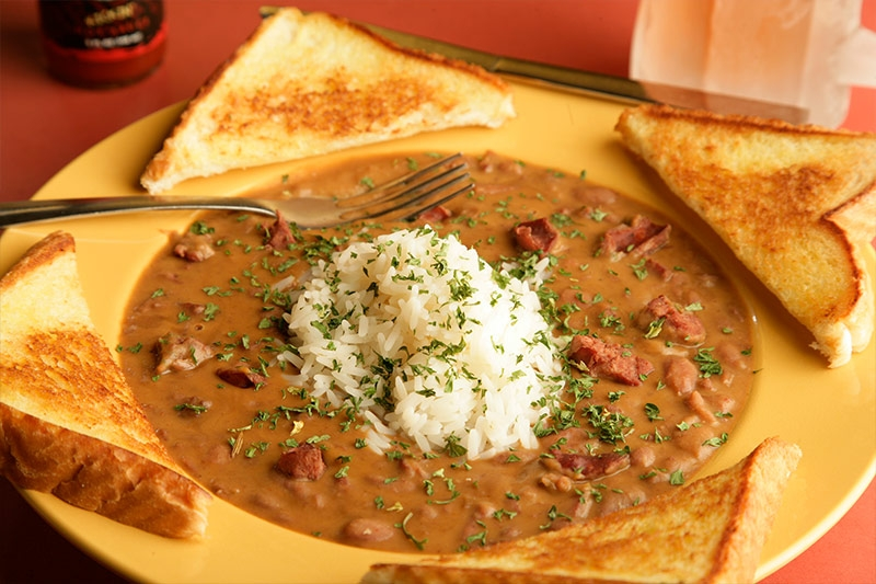 Delicious red beans and rice served with side of toast