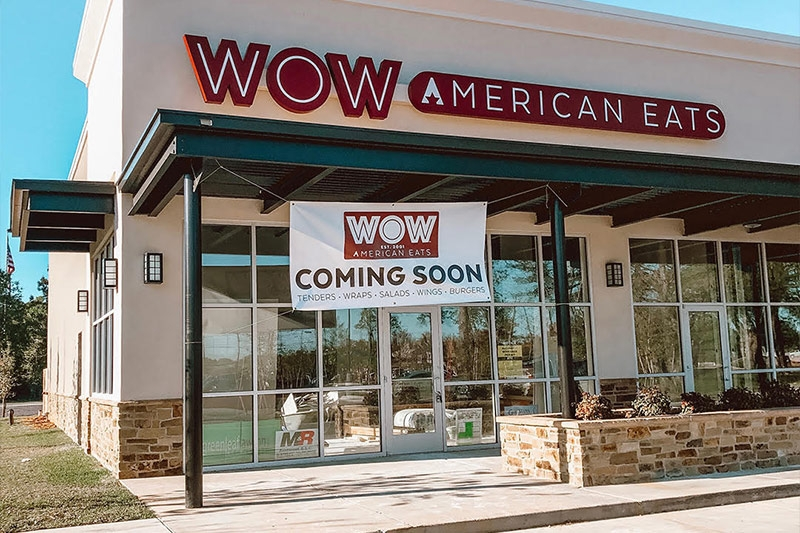 New WOW American Eats location in Covington, Louisiana with Coming Soon sign outside