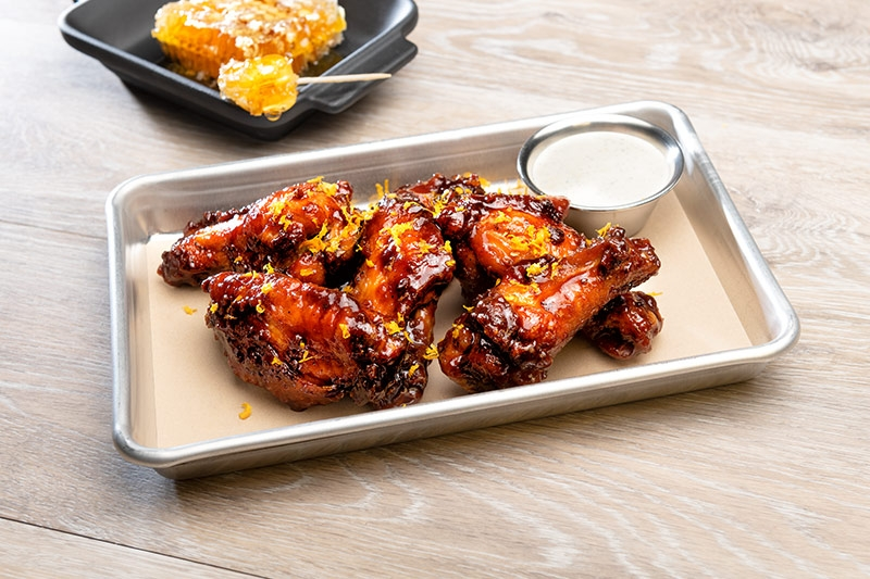 Kansas City chicken wings served dressed on silver serving tray