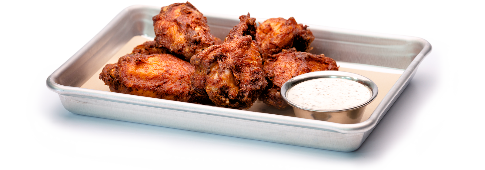 Wings on platter with sauce